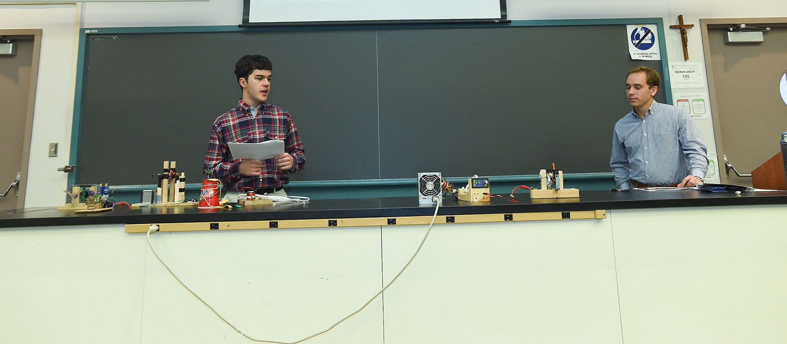 Physics students presenting in class