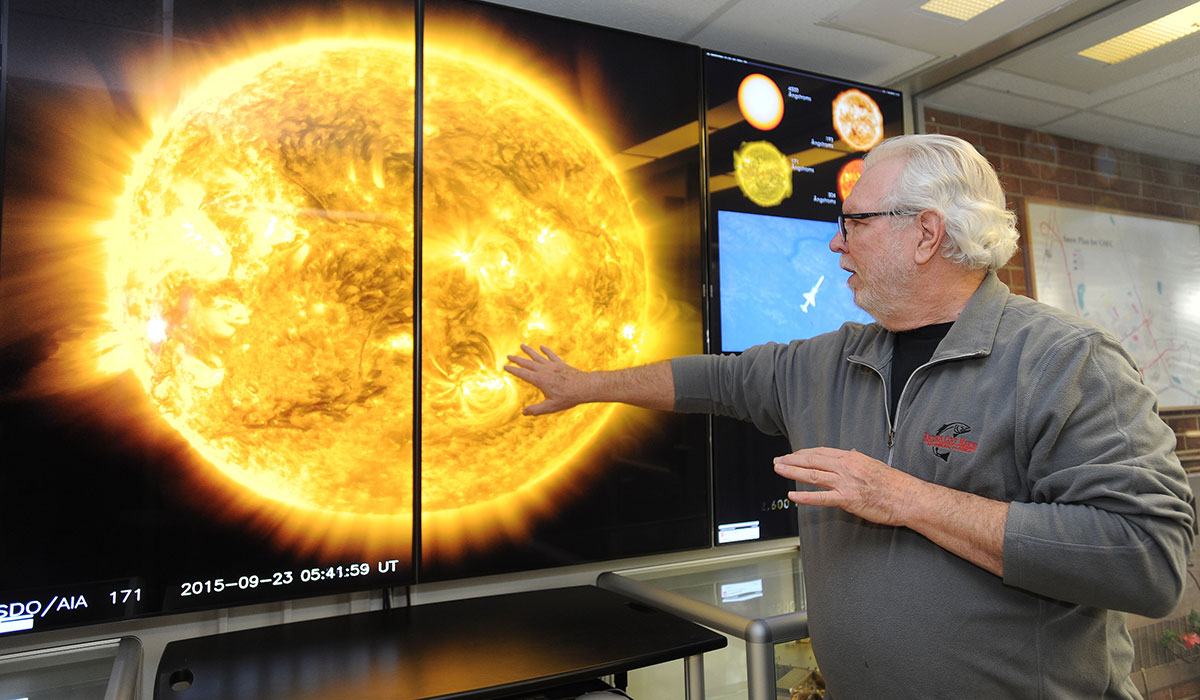Researcher studying sun